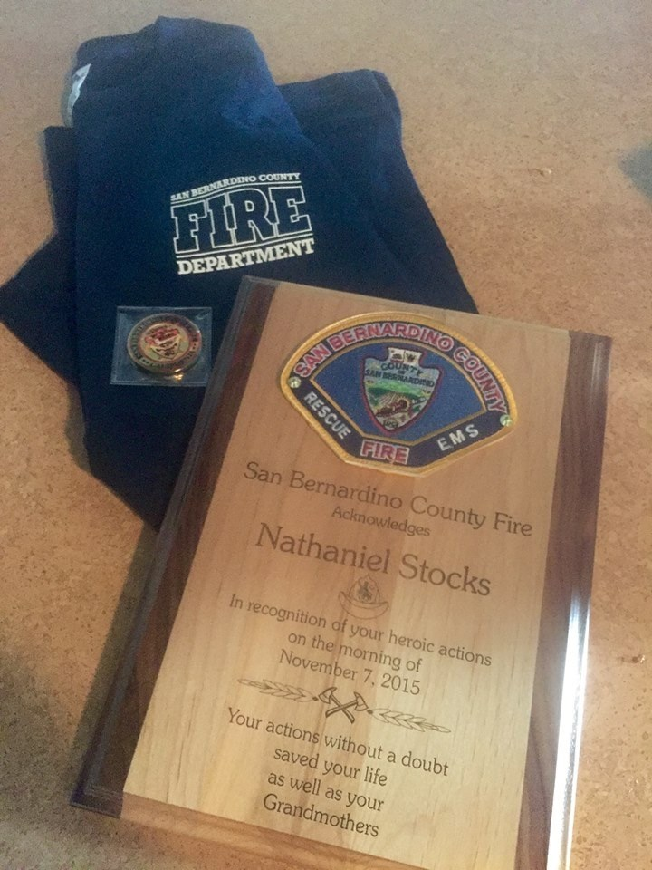 Natanielis Stocks was honored by his local fire department after saving his grandmother's life during a fire