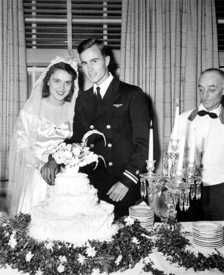 George and Barbara Bush cut their wedding cake, Rye, New York.