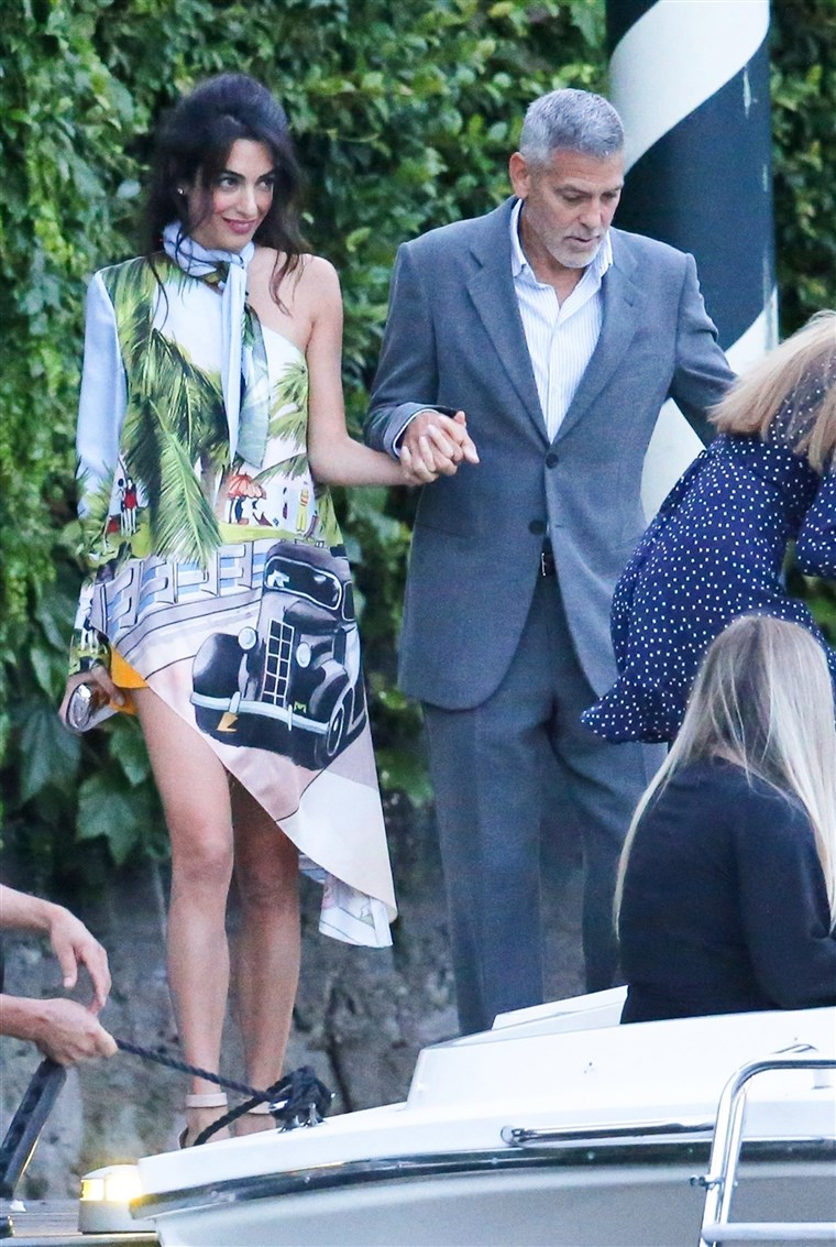 George and Amal Clooney take a boat ride with friends to Villa D'Este restaurant