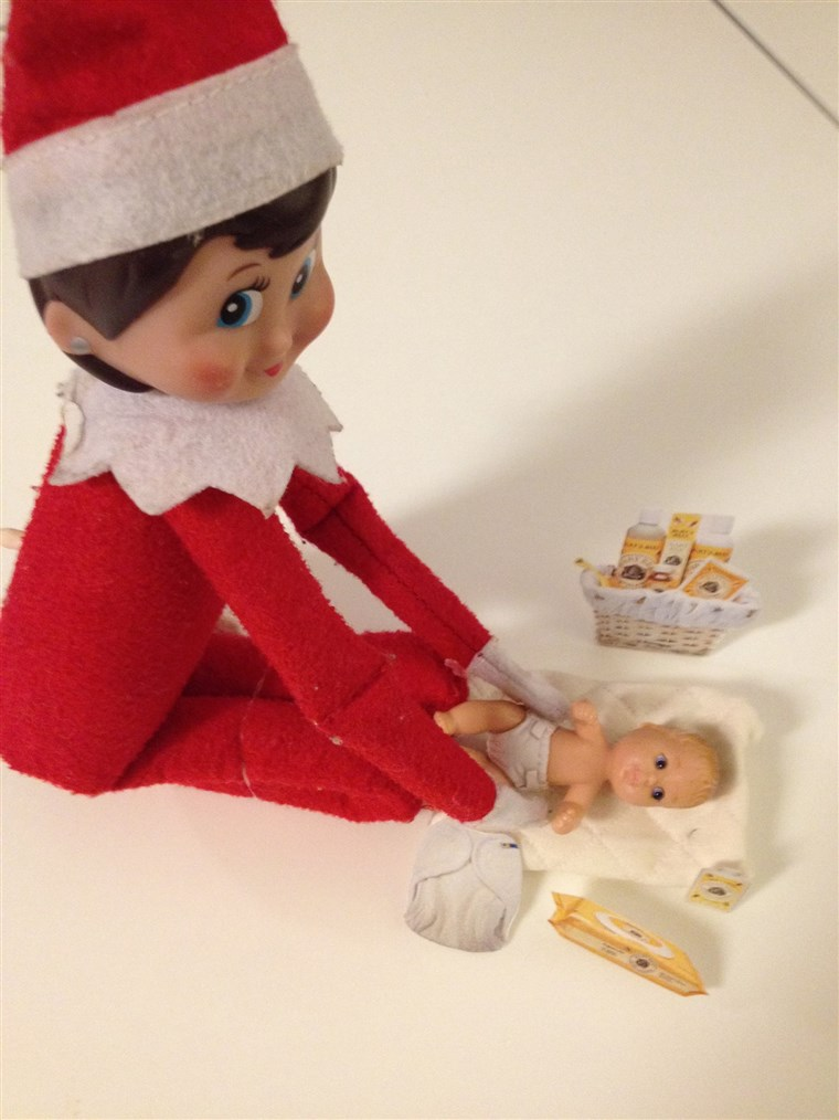 Тхе Elf changes baby doll diapers!