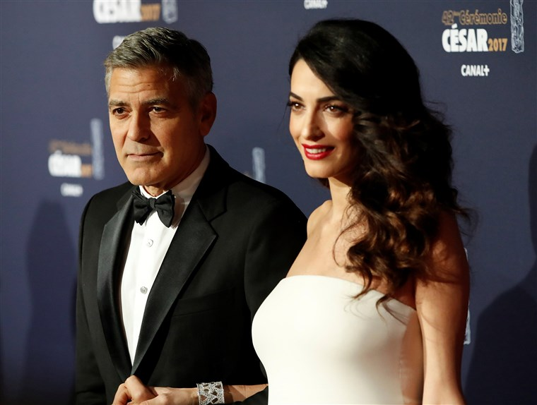 Vaizdas: FILE PHOTO: Clooney and his wife Amal pose as they arrive at the 42nd Cesar Awards ceremony in Paris