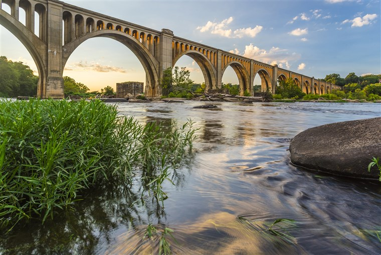 Tai concrete arch railroad bridge spanning the James River was built by the Atlantic Coast Line, Fredericksburg and Potomac Railroad in 1919 to route transportation of freight around Richmond, VA.