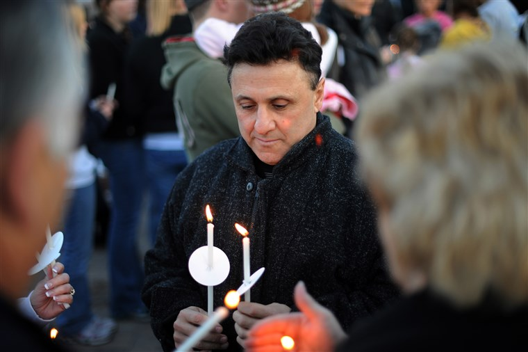 искрен Deangelis of Columbine High School Principal is in candlelight Vigil to honor and remember those touched by the tragedy at the Columbine Memorial in Clement Park, Littleton, CO. on Sunday. Hyoung Chang, The Denver Post