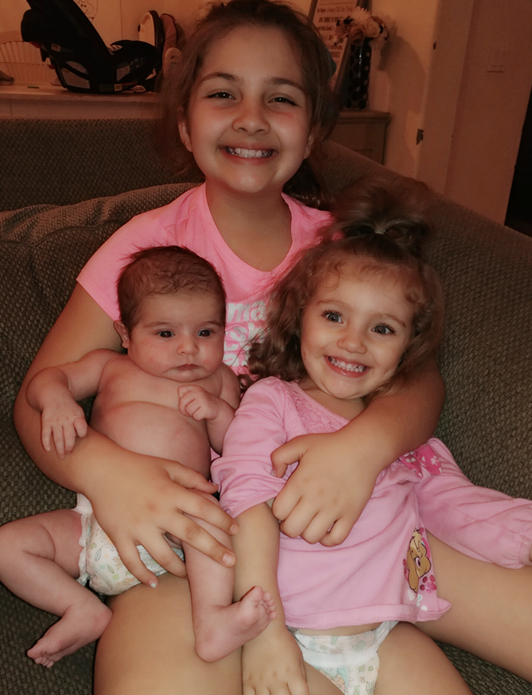 Brooke with her sisters, Ellie, 2, and Summer, 5 weeks.