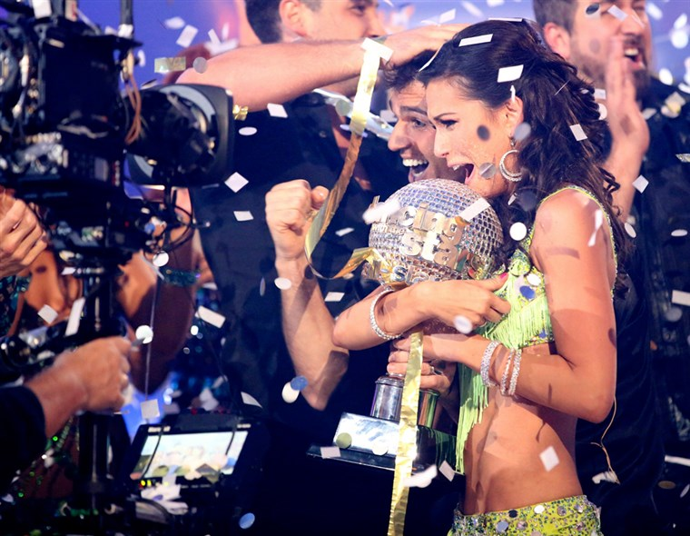 Melissa Rycroft and pro partner Tony Dovolani hold the mirror ball trophy as they are crowned champions on the season finale of ABC's