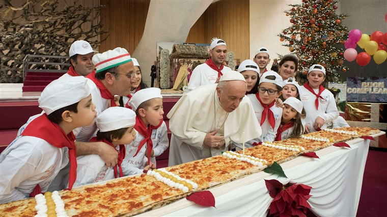 Imagine: Pope Francis blows on a cake to celebrate his birthday during a special meeting at Paul VI hall at the Vatican