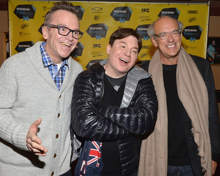 AUSTIN, TX - MARCH 09: Comedian Tom Arnold, drector Mike Myers and producer Shep Gordon pose for pictures in the green room for the premiere of