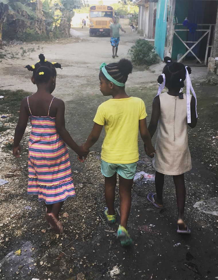 Missy visits with other children from her village during a recent trip to Haiti.