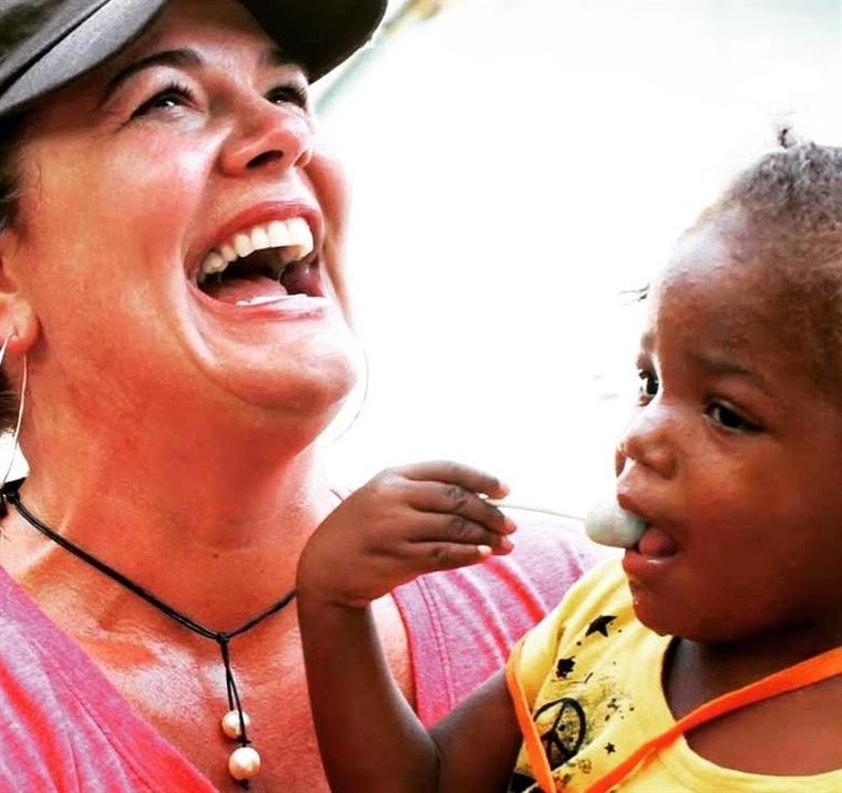 Harpist and Missy's first meeting, in Haiti in 2012, when Missy was 2 years old.