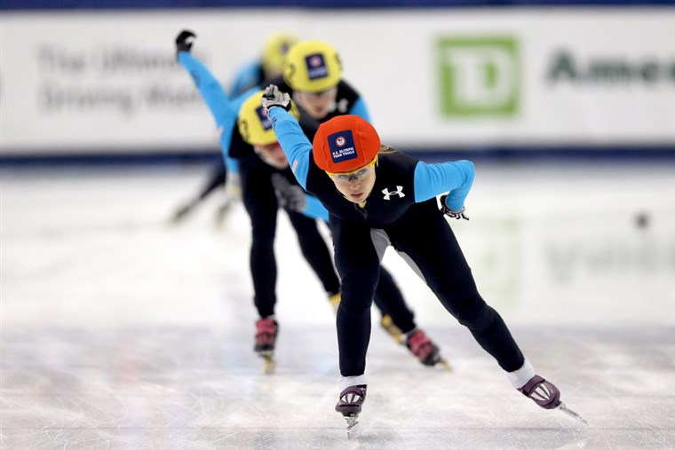 Sportininkai compete in a 1,000 meter final during the Olympic short track trials at Salt Lake City's Olympic Oval on January 5.