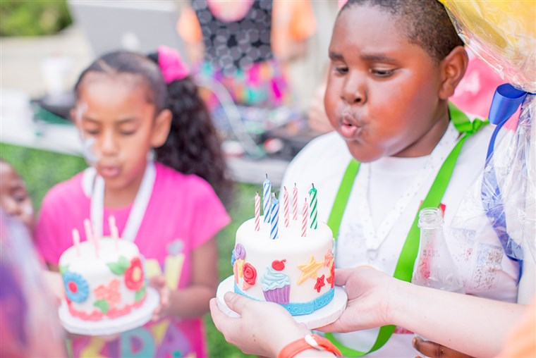 Benamiai children blow out their birthday candles in Dallas.
