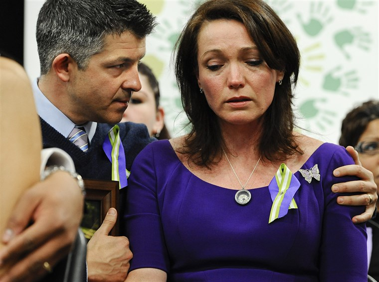 Ian and Nicole Hockley, parents of Sandy Hook School shooting victim Dylan, listen at a news conference at Edmond Town Hall in Newtown, Conn., Monday,...